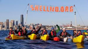This April 17, 2015 photo shows a group of kayakers letting out a yell after successfully pulling up a protest sign as they practice for an upcoming demonstration against Arctic oil drilling, in Elliott Bay in Seattle. Seattle Mayor Ed Murray said Monday, May 4, 2015, the Port of Seattle can't host Royal Dutch Shell's offshore Arctic oil-drilling fleet unless it gets a new land-use permit. Shell has been hoping to base its fleet at the port's Terminal 5, near where protesters plan a mass kayak protest later this month. (AP Photo/Elaine Thompson)