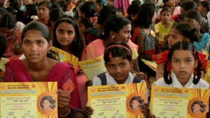 "Girls hold certificates stating their new official names during a renaming ceremony in Satara, India, Saturday, Oct. 22, 2011. Almost 300 Indian girls known officially as ""Unwanted"" have traded their birth names for a fresh start in life. Given names like ""Nakusa"" or ""Nakushi"" _ or ""unwanted"" in Hindi _ they grew up understanding they were a burden in families that preferred boys in Maharashtra state. (AP Photo)"