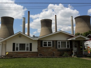 The John Amos coal-fired power plant is seen behind a home in Poca
