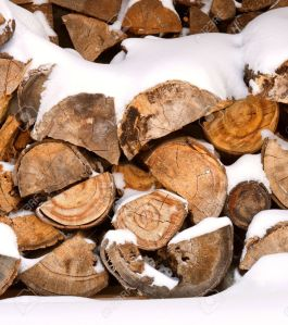 6786303-A-stack-of-firewood-covered-in-snow--Stock-Photo